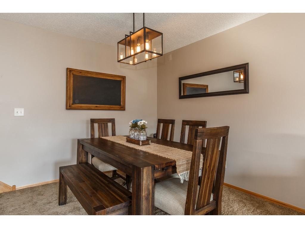 Charming dining room with updated fixtures.