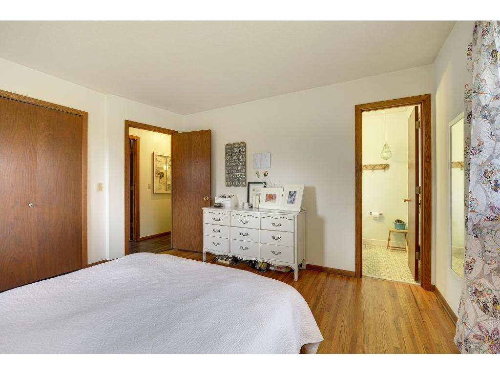 Master bedroom on main level with half bath. New light fixture and fan in bathroom.