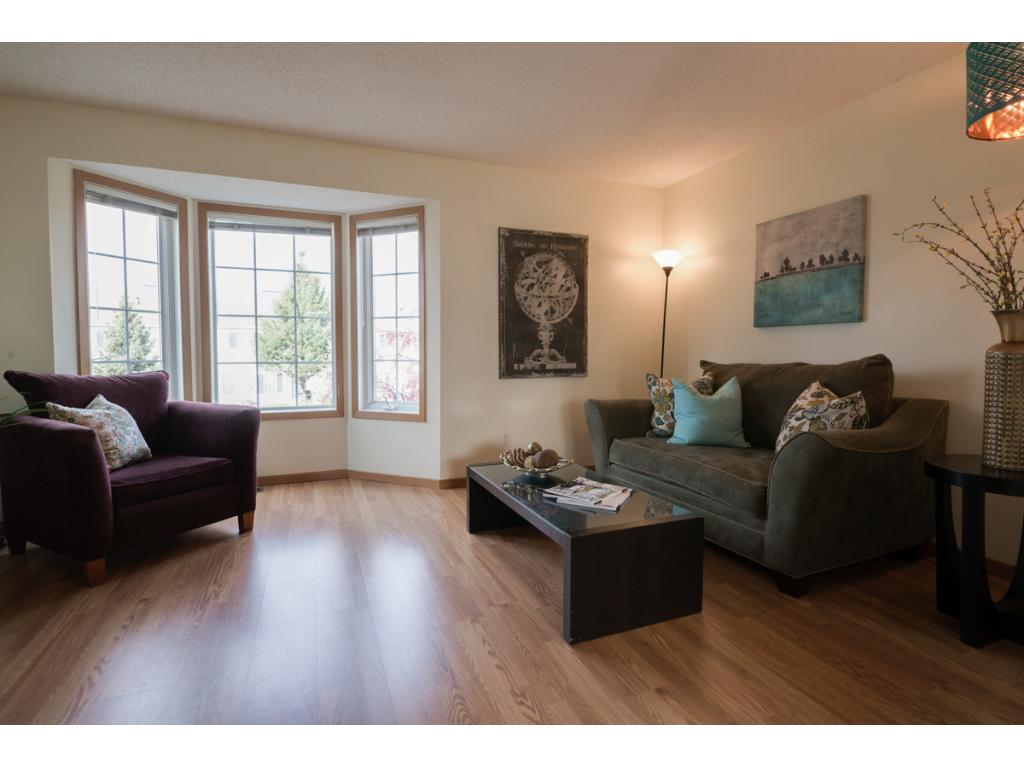 Main level family room has a wonderful bay window to bring in the light.