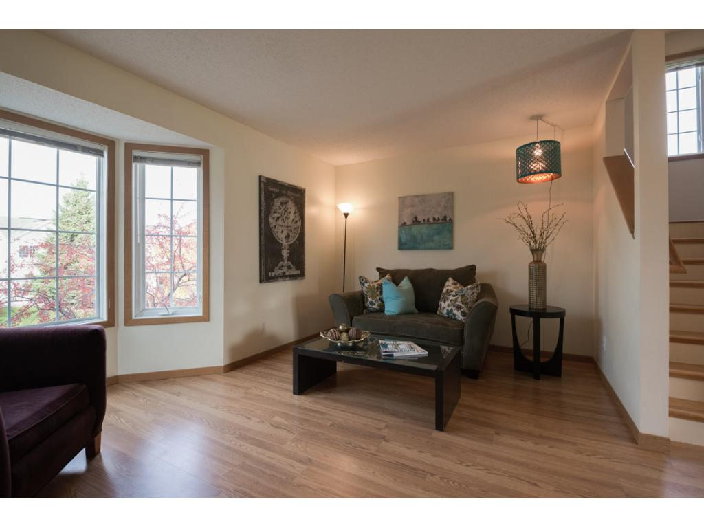 This view of the family room looks into the dining area and kitchen.