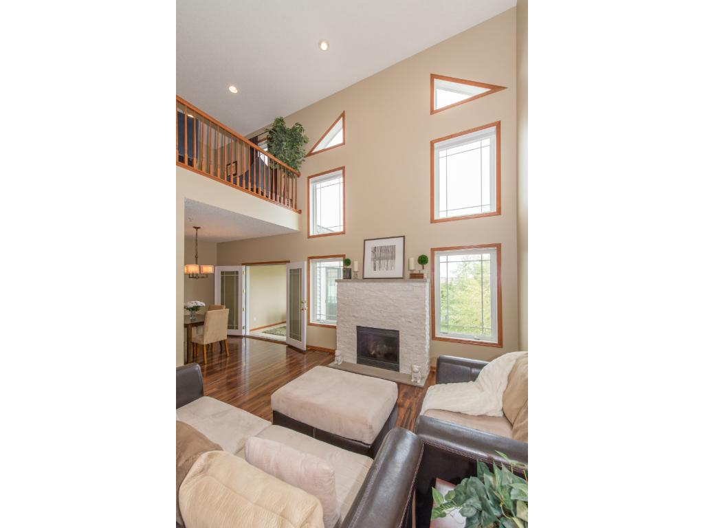 Two Story Great Room with White Granite Gas Fireplace