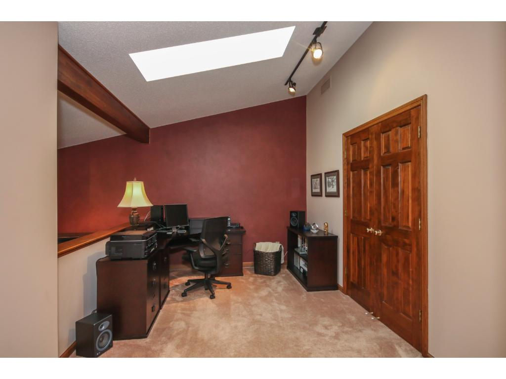 The loft area over looks the living room and features a skylight! A perfect quiet space for an office or den!