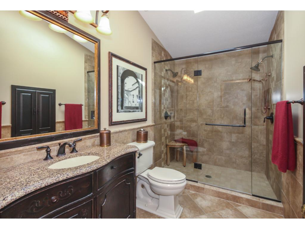 The master bath was recently renovated and updated in 2009 to include a large, beautifully tiled, walk-in shower!