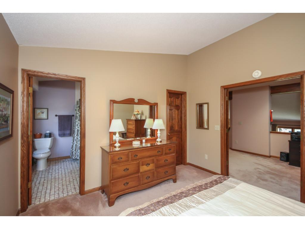 The guest bedroom is a second private master and features an updated bath and a large walk-in closet! Guests may not want to leave!