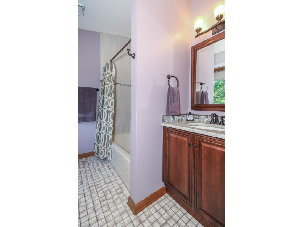 Guest bath was updated in 2015 and features pretty new tile and detailing around the tub!