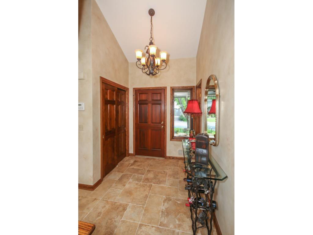 Open, two-story foyer includes a large entry closet and a convenient powder room!