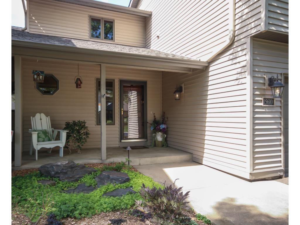 Professionally landscaped front with outdoor lighting to welcome your guests!
