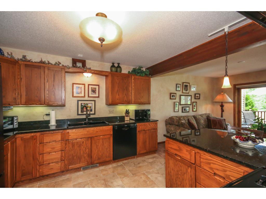 Kitchen includes a large pantry closet,  pullout shelving and under-cabinet lighting!