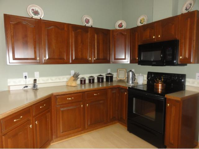 Cherry Cabinets in open Kitchen