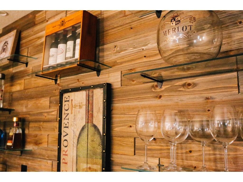 Custom wet bar in lower level with barnwood wall for sure will impress all your guests!