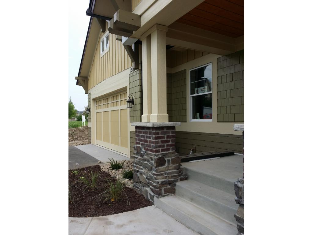 This lodge inspired luxury townhouses feature inviting front porch with extensive architectural exterior details.