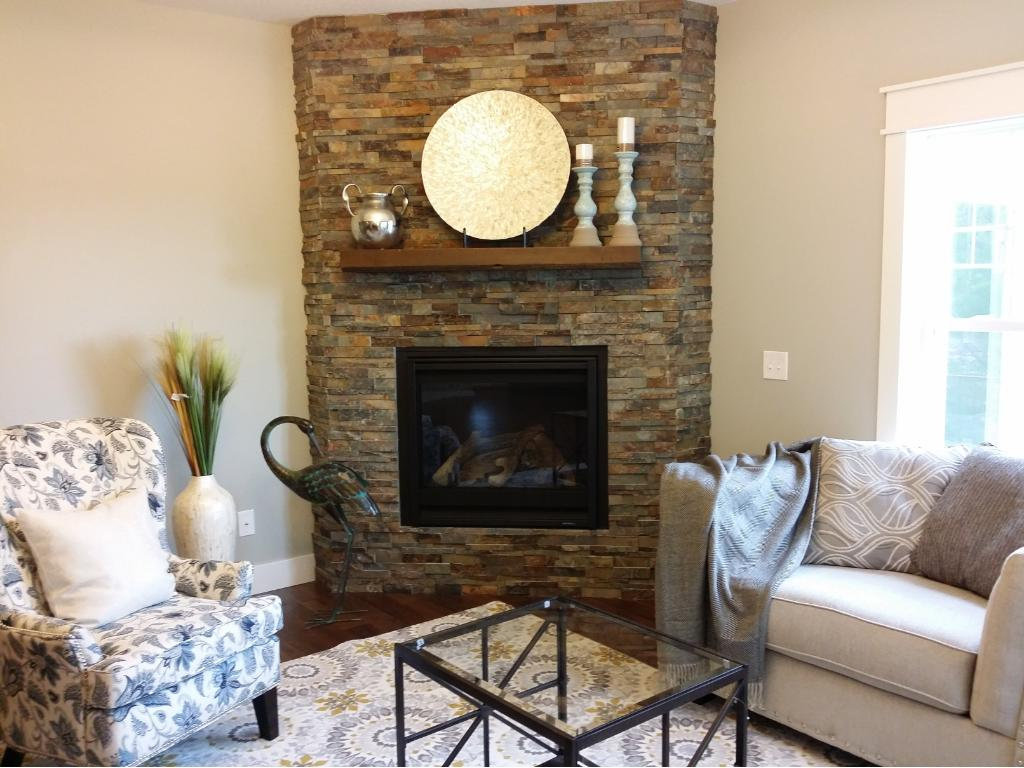 Floor to ceiling stone fireplace with custom reclaimed barnwood mantel.