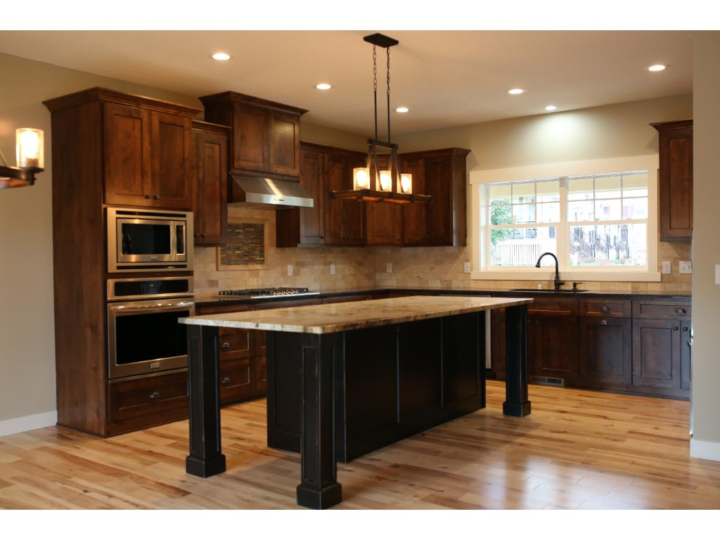 Custom knotty alder kitchen with Energy Star SS appliances and oversize central island.