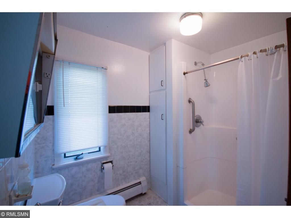 Mainfloor 3/4 bath has large linen closet, updated shower with seat and a window to keep it light and airy.  The home has much more storage than usual for this era, main floor laundry, kitchen closet,  the floorplan was well thought out from day one!
