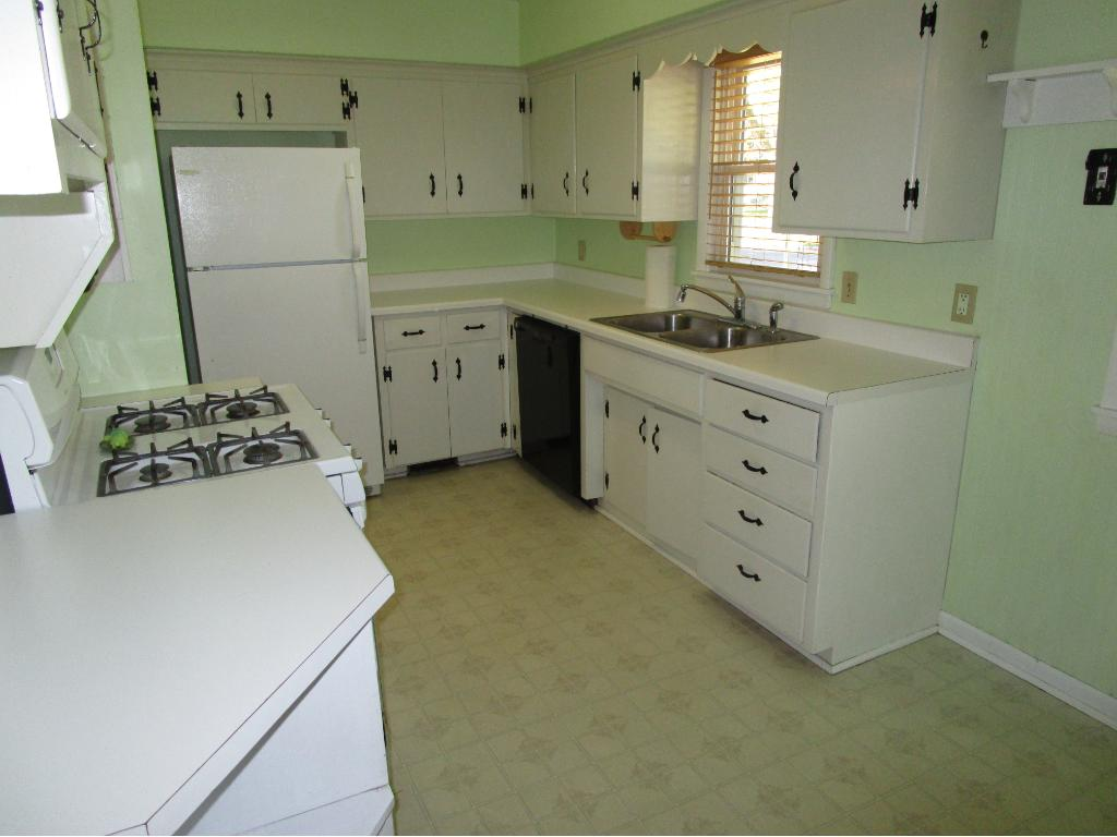 Spacious kitchen with ample storage for this era and price point.