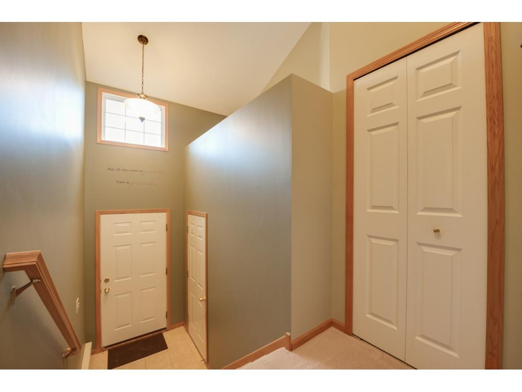 Front foyer offers convenient access to the attached 2-car garage & coat closet for extra storage.