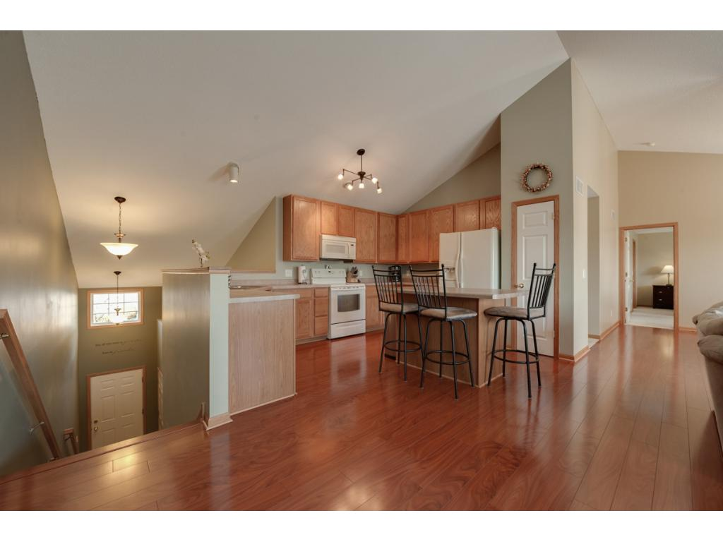 "Kitchen provides many 42"" cabinets, pantry closet with wire shelving, center island with breakfast bar seating."