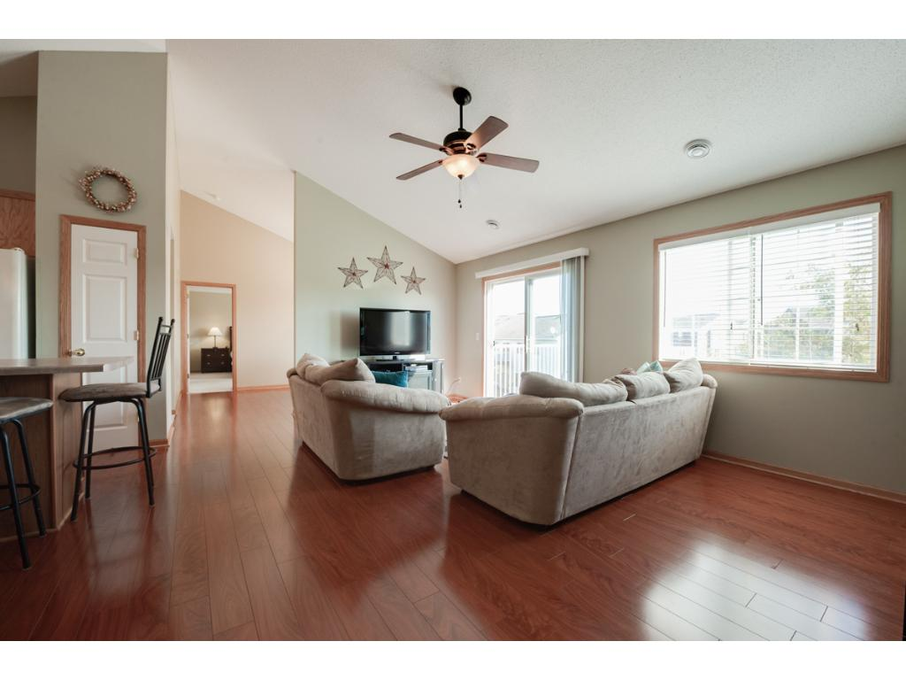 Lovely living room with large sun filled windows. Durable laminate floors extend thru-out the dining and living spaces.