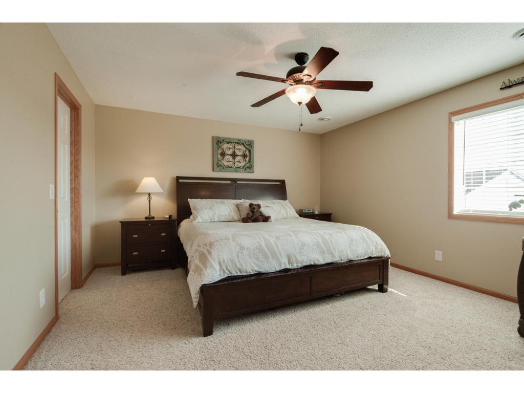 "Delightful master suite features an updated lighted ceiling fan, window & large walk-in closet. 2"" blinds can be found thru-out the home."