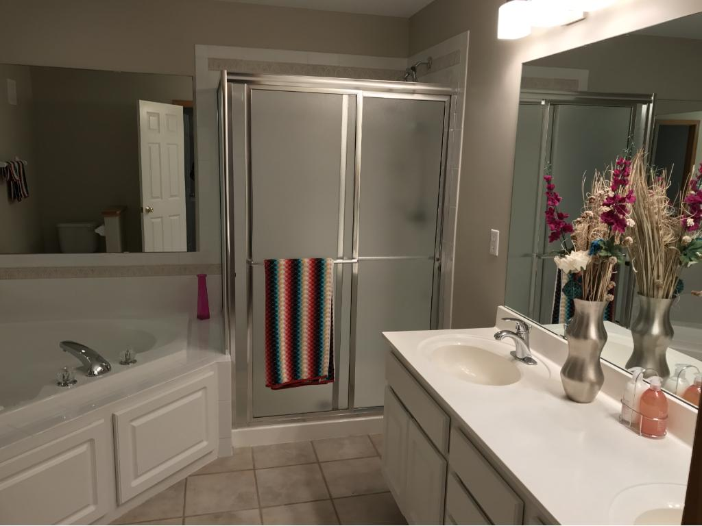 Large Master Bath with whirlpool, separate shower, double vanity, ceramic tile flooring...