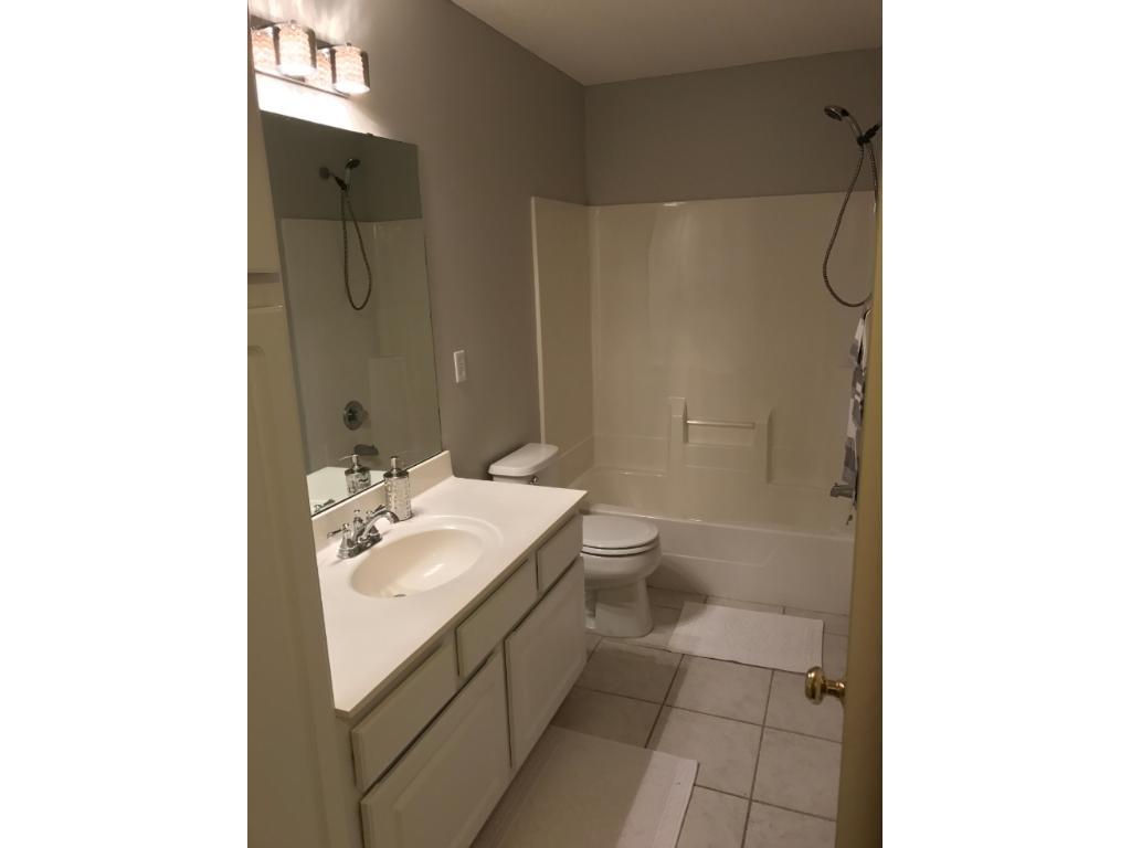 Public Bathroom with new light fixture, faucet, paint and ceramic tile flooring.