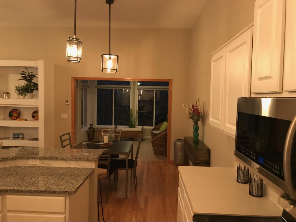 Heated floors in the end unit sunroom. Dining room and kitchen bar...