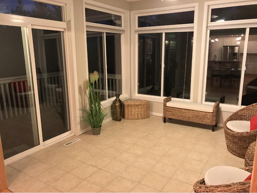 Eastern exposed Sunroom, heated ceramic tile, with floor to ceiling windows and freshly stained deck...