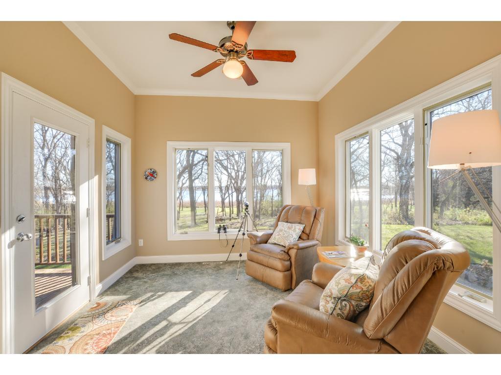 Beautiful main level sunroom! Enjoy the gorgeous backyard views & access to the deck!