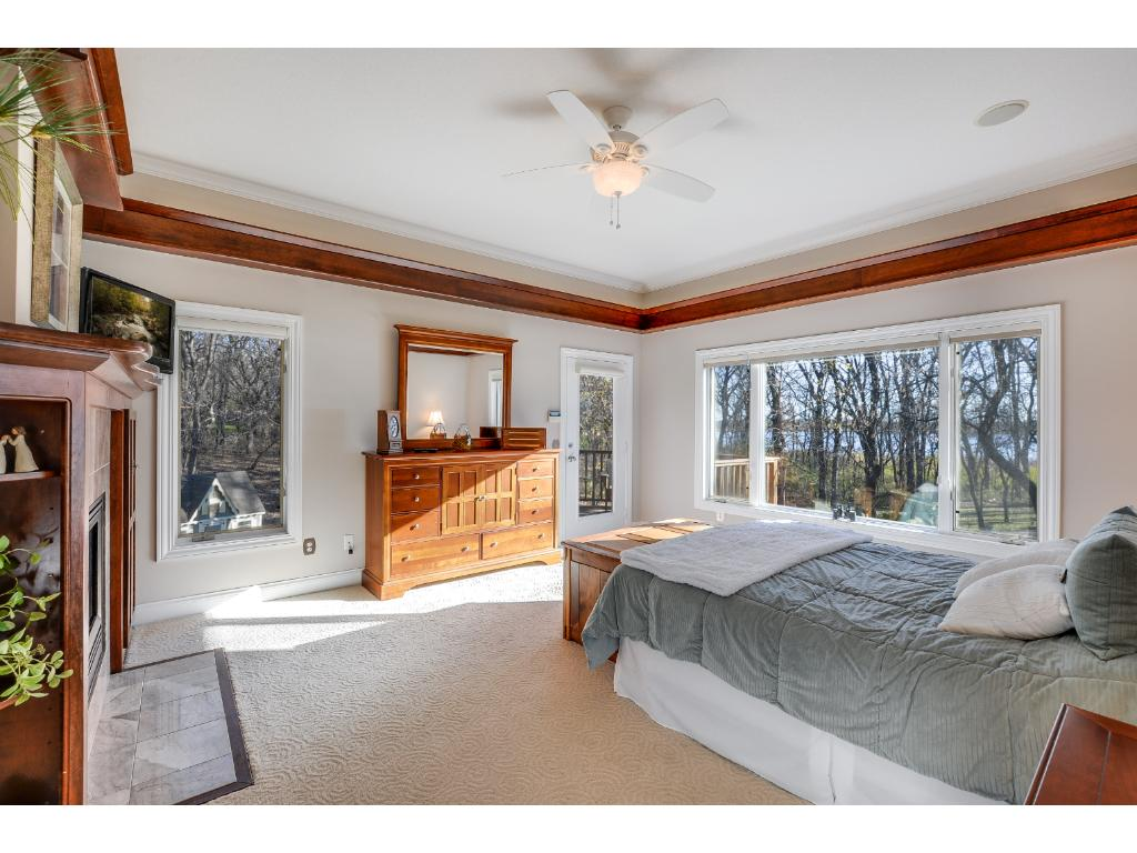 Gorgeous Master Suite oasis! Large picture window w/ backyard views, private deck to enjoy your morning cup of coffee, a private master bathroom w/ a walk-in shower & separate oversized tub, and a huge walk-in closet!