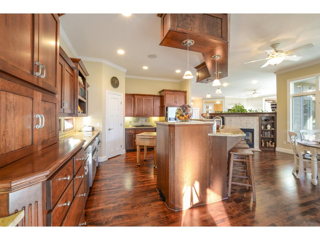 Incredible storage space in this kitchen including a walk-in pantry! Two ovens to use! Gorgeous island w/ an eat-in area, dual sink, and beautiful pendant lighting!