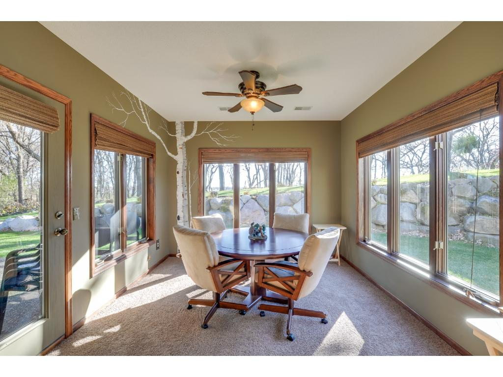 Gorgeous lower level sunroom! Great views of the backyard & access to the patio!