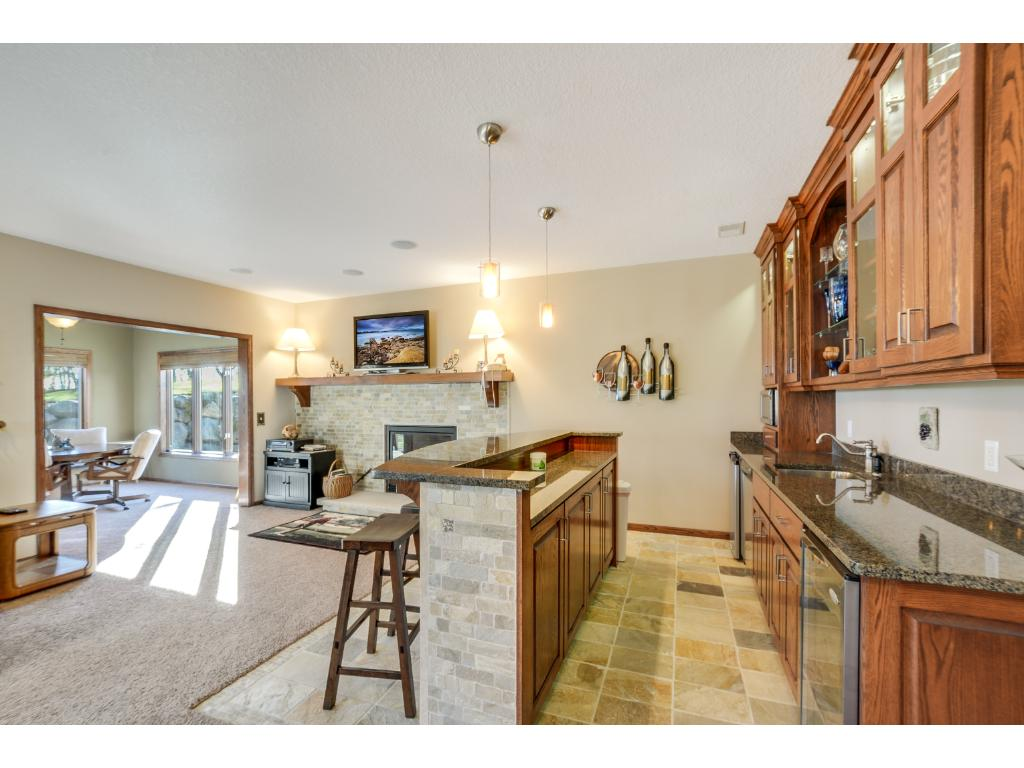Fully finished LL complete with a bar area, making for a great place to entertain guests! Lower level features the third fireplace, recessed lighting, surround sound system, 3 bedrooms, a bathroom, the wine cellar, rec room, and a 2nd sunroom!