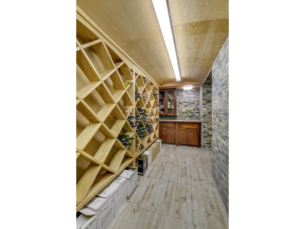 Custom brick wine cellar w/ tile flooring! Huge highlight of the home!