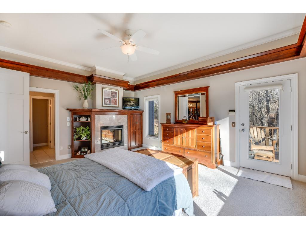 Double sided fireplace to enjoy in the private master suite! Master suite also has a private walk-out deck!