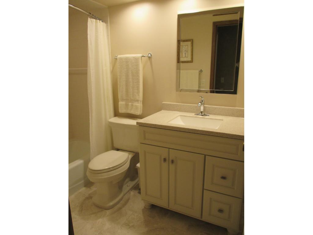Main floor bath serves corner BR