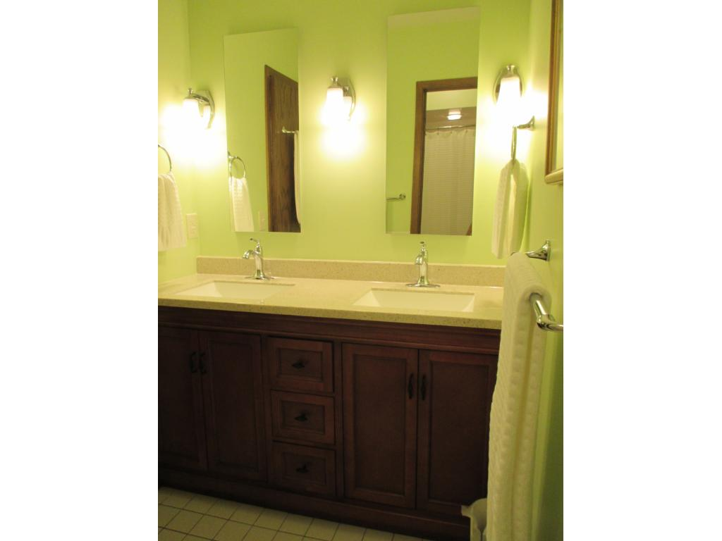 Lower level bath with double vanity serves 3 BRs.