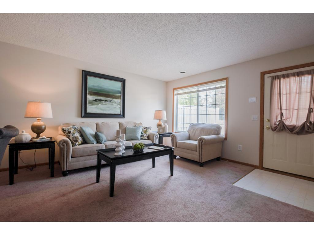 Welcoming Living Room Features Large Sun Filled Gridded Windows U0026 9 Ft.  Ceiling Is