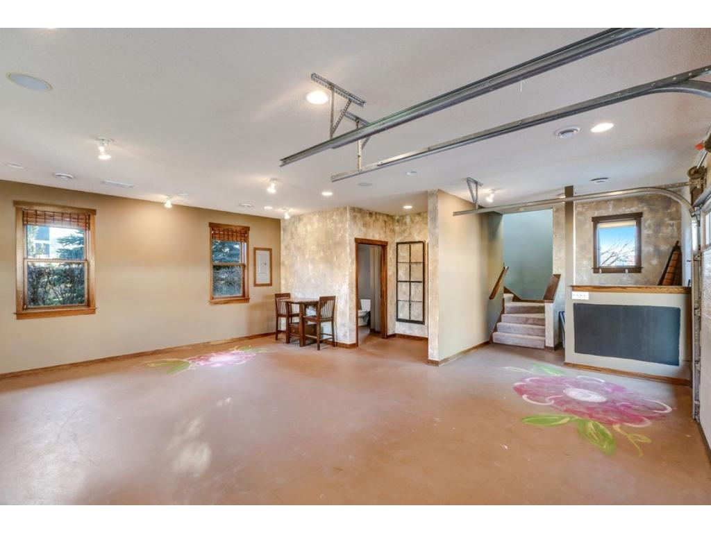 """Interior of the 2-car garage is fully finished and boasts separate heat/AC, spacious 1/2 bath, abundant recessed + spot lighting, surround sound, and so much more! Use for recreational/seasonal storage or as a """"man cave""""!"""