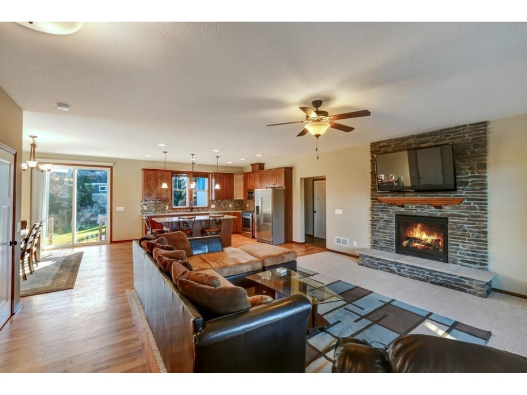 Delightful view of the main level living...including the beautiful fireplace with custom mantle and raised hearth. Entertaining here is a breeze!