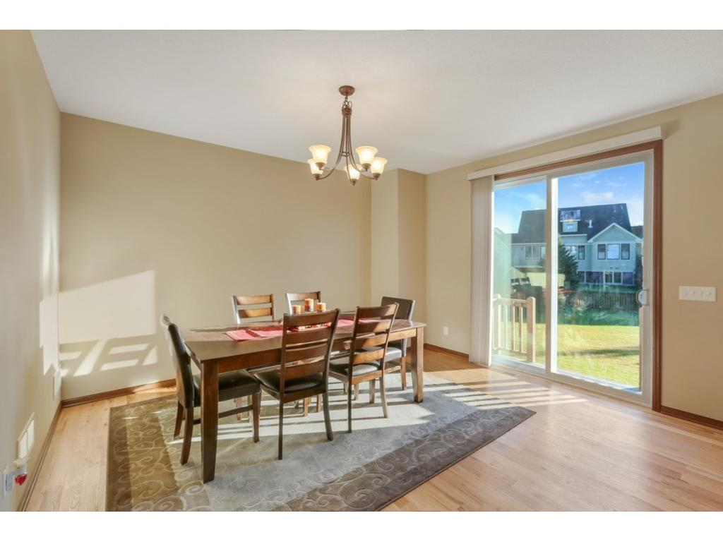 Lovely dining room stays out of the way, yet is wonderful for entertaining large groups or quiet family evenings at home. Sliding glass doors open to an excellent backyard and custom patio/fire pit.