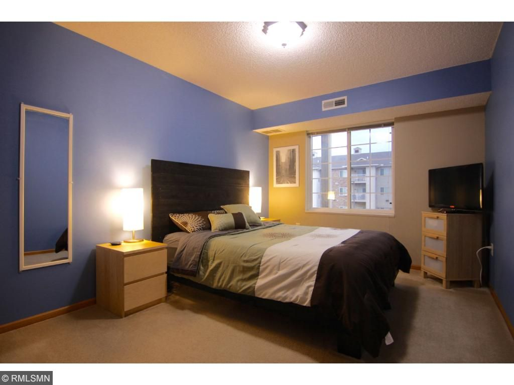 One of two bedrooms, this one has a large walk in closet and private bath.