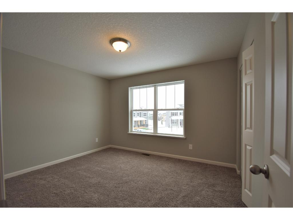 Semi private 2nd bath.  Photos are of same floor plan.  Options and color selections will vary.