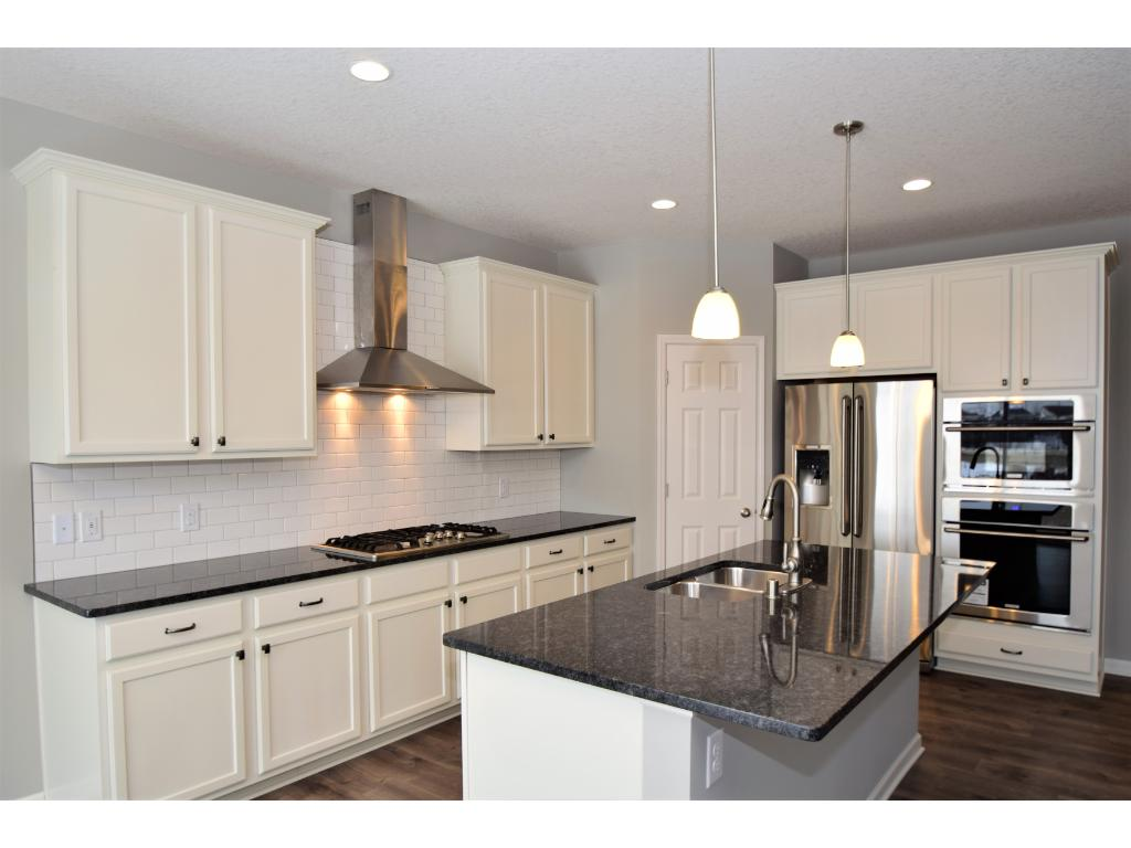Linen maple cabinets and granite counter tops.  Photos are of same floor plan.  Options and color selections will vary.