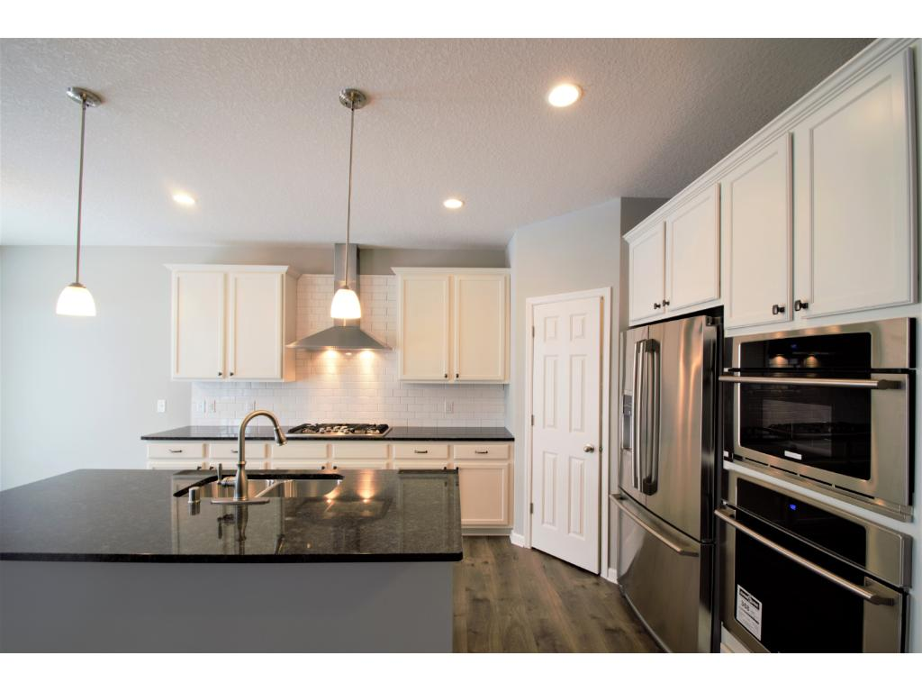 9ft ceiling on main floor feels open and bright.  Photos are of same floor plan.  Options and color selections will vary.