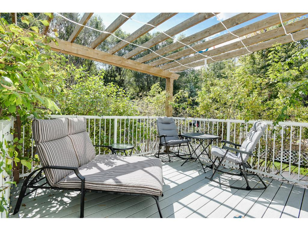 Imagine relaxing on your deck, private with the pergola and beautiful flowers helping you enjoy a nice late summer, early fall day!