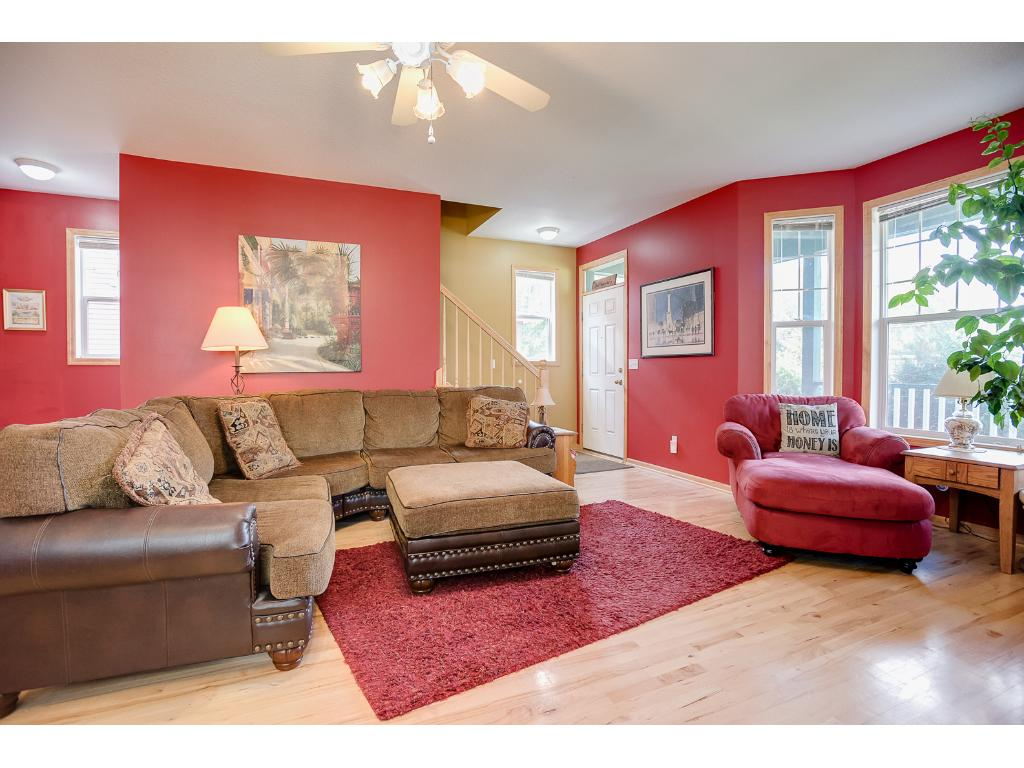 The living room is spacious with room for whatever seating arrangement you are comfortable with as you lounge and enjoy the warmth from the fireplace.