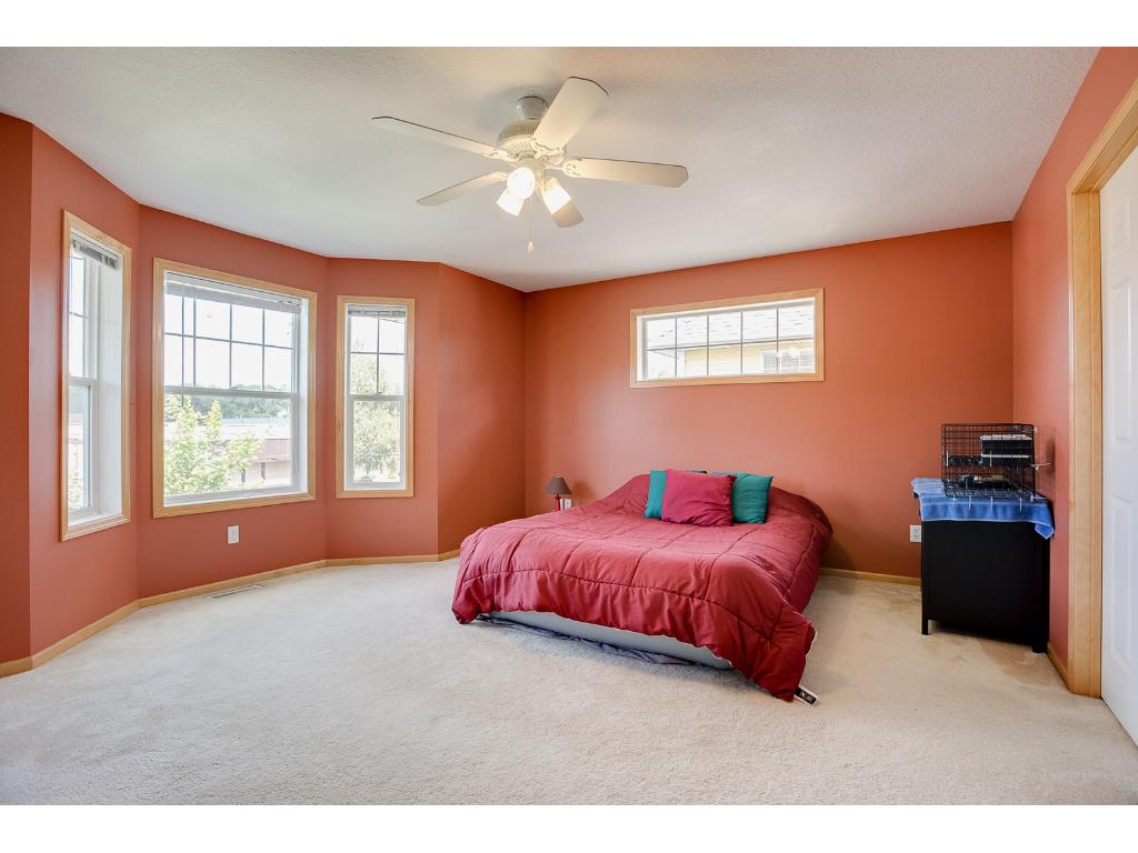 The master bedroom upstairs is huge, with a bay window bringing in extra light and so much room for any size furniture arrangement you desire.