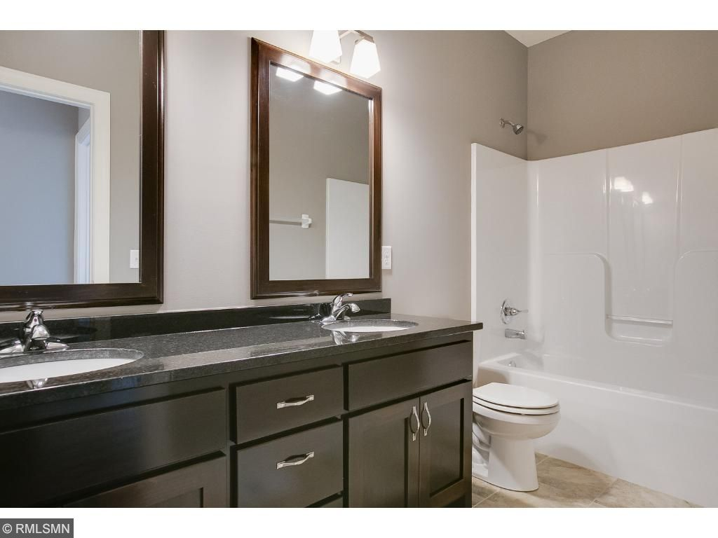 Main level full bath with double vanity.