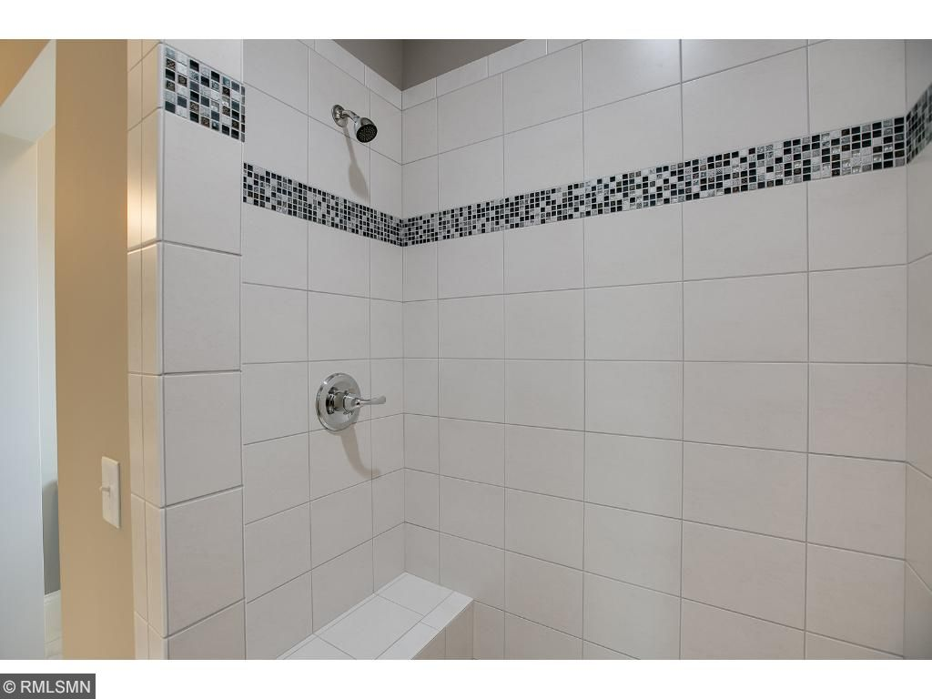 Master bath with tile walk in shower.