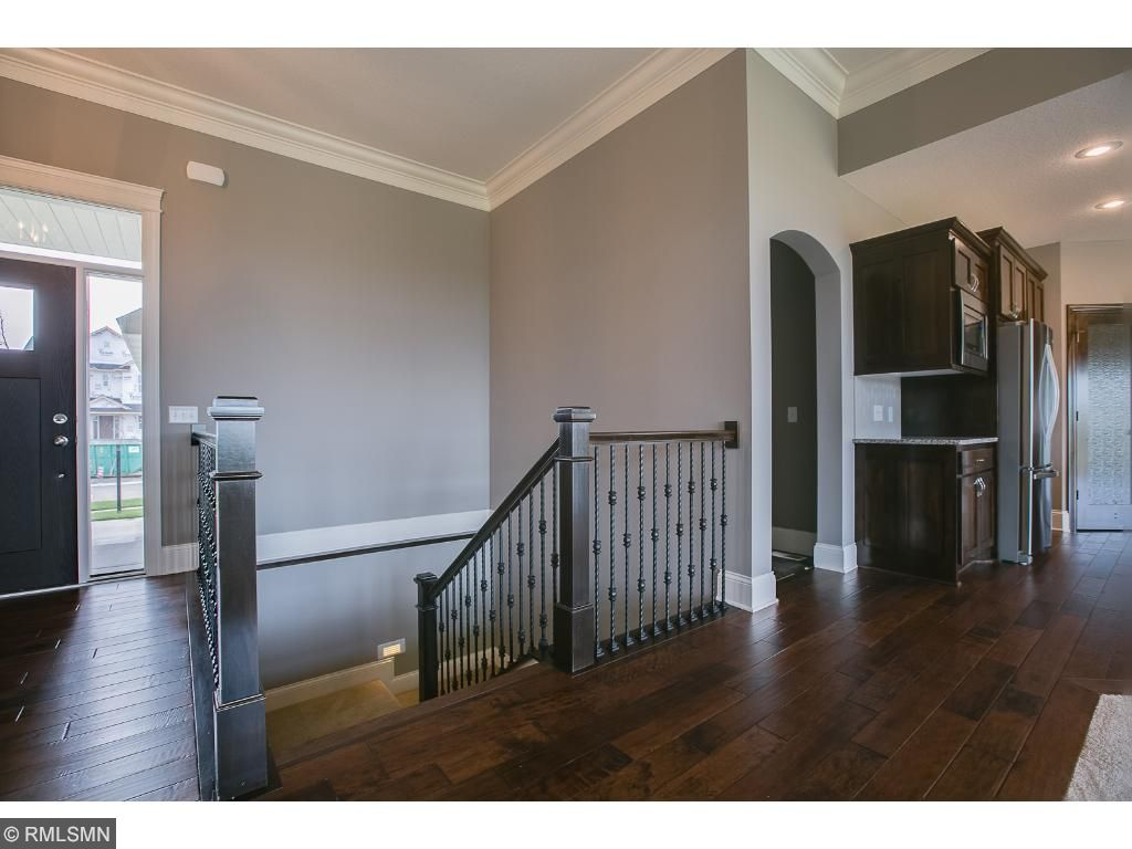 Entry with with stairway leading to basement.
